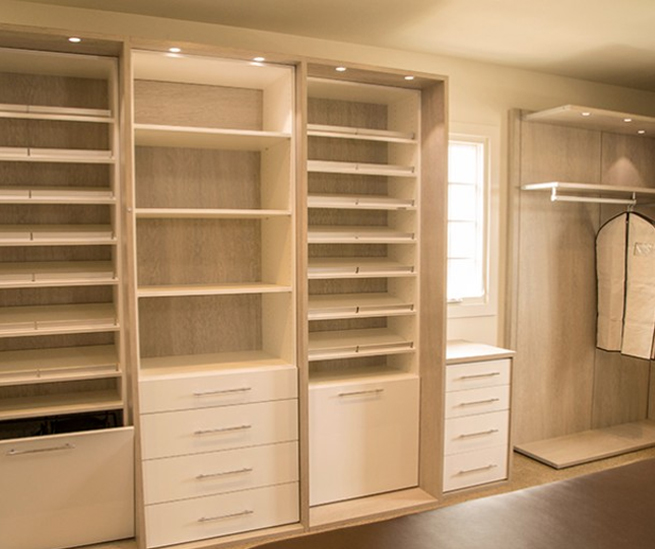 California Closets White Walk in Closet with Shelves Drawers Closet Rods and Built in Lighting