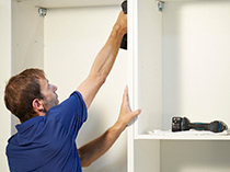 California Closets Installing White Shelving
