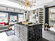 Walk in Closet with Shelving Bench Seating Island Dresser Body Length Mirror and Chandelier Lighting