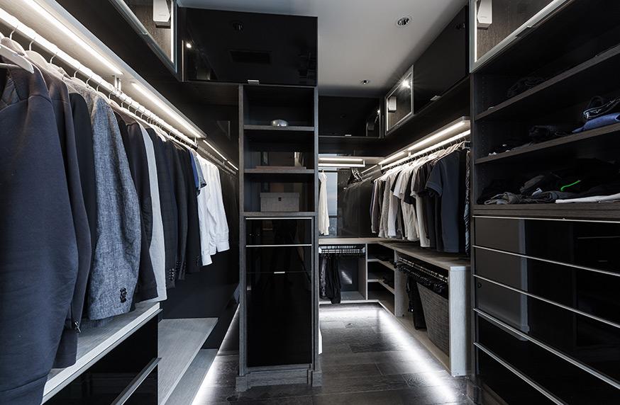 Dark walk in closet with lighted walk way